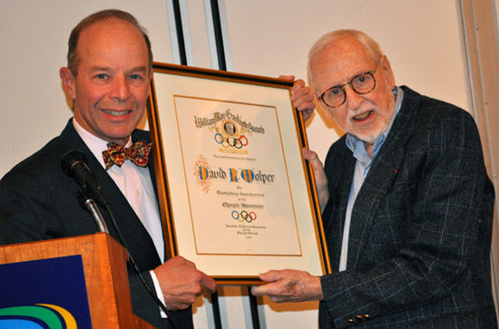 David Wolper, right, receives the William May Garland Award from SCCOG Chairman Barry Sanders.